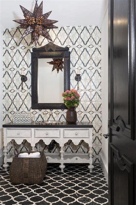 moroccan style powder room  black marble quatrefoil