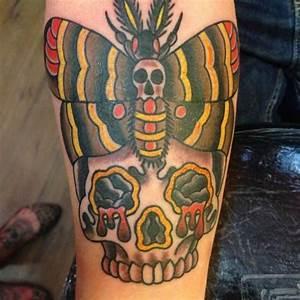 Arm Old School Skull Moth Tattoo by Triple Six Studios