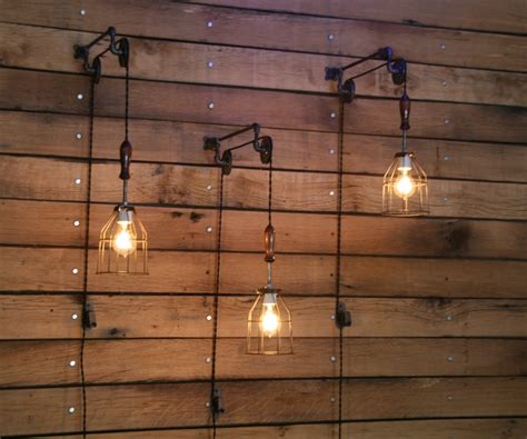 pulley wall with industrial cage light and wooden handle