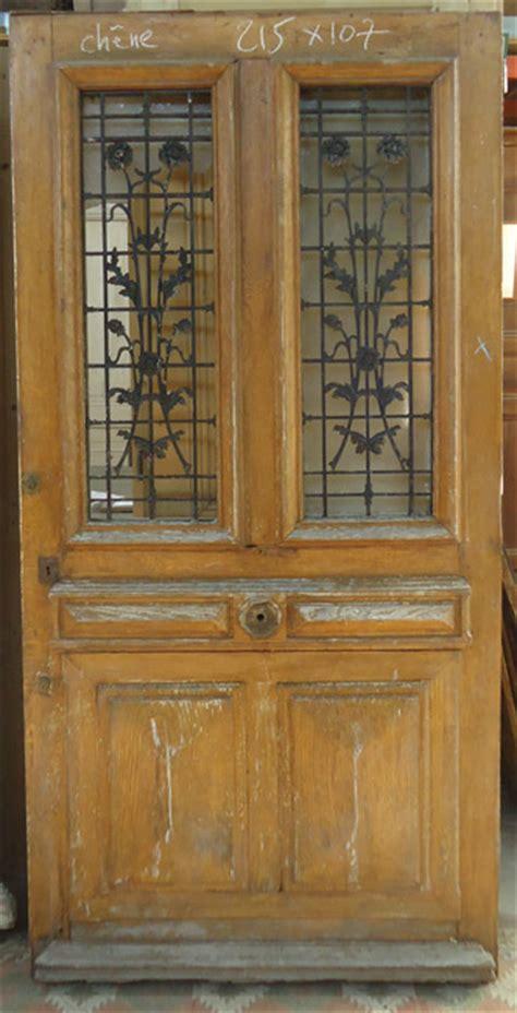 telematin cuisine porte d 39 entrée bois massif chêne vitrée avec grille fer forgé