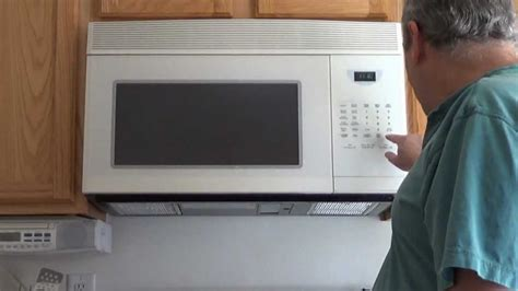 how to hang a microwave under a cabinet over the range microwave oven installation of youtube