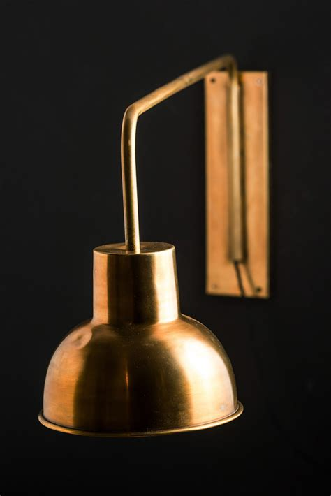 cozy reading nook with swing arm wall sconce l brass
