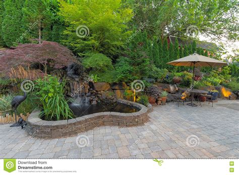 Backyard Landscaping Patio With Waterfall Pond Stock Photo