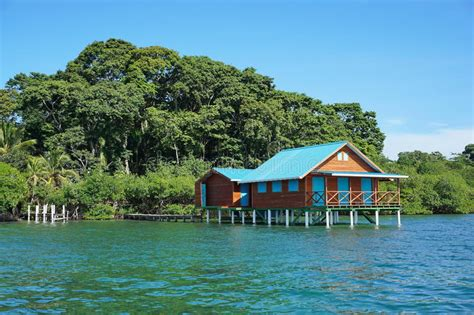Overwater Bungalow With Lush Tropical Vegetation Stock