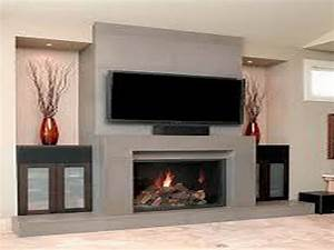 Decorations decorating a fireplace mantel wall tv