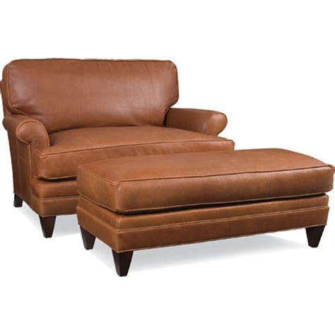 leather chair and ottoman with a half brown leather
