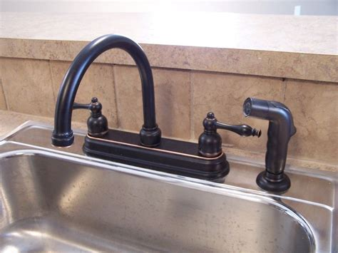 Black Bronze Kitchen Faucets With Stainless Steel Sink