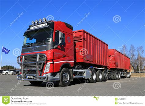 red volvo truck red volvo fh truck with full trailer and blue sky