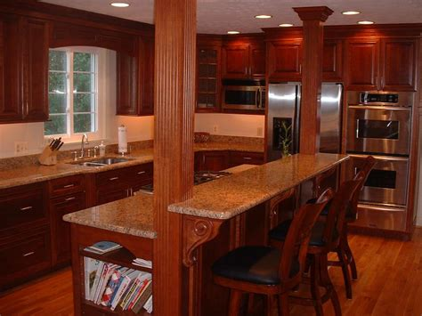 kitchen island with granite top and breakfast bar structural beams in the kitchen we made them into