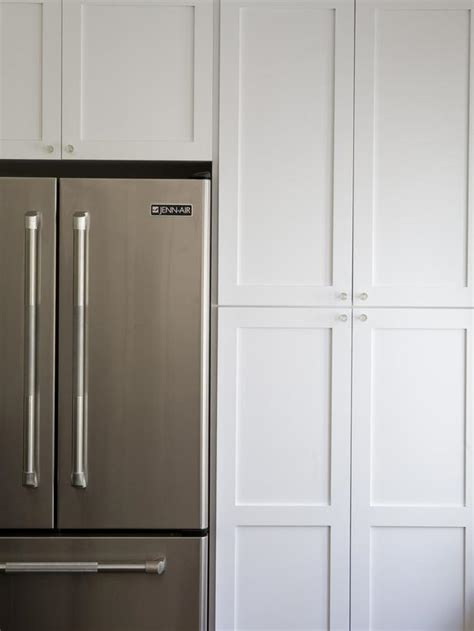 cabinets around fridge traditional kitchen with stainless steel refrigerator