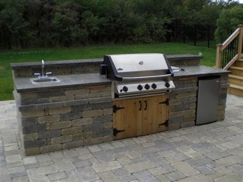 outdoor kitchen island with sink an outdoor kitchen with napoleon grill sink and fridge