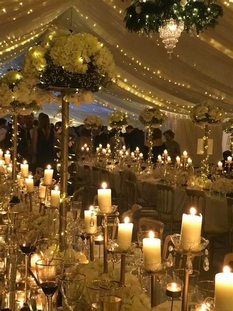 winter wedding marquee candles  white flowers