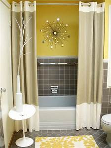 Accessorize everything for this perky powder room hgtv fan for Gray and yellow bathroom