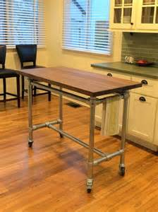 rolling kitchen island table 1000 ideas about rolling table on office guest bedrooms rustic kitchen island and