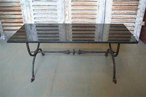 spanish 1940s wrought iron coffee table with black granite With granite top coffee tables for sale