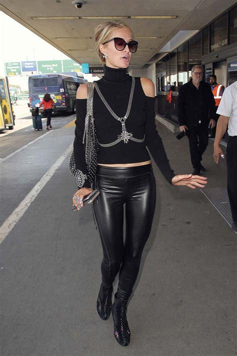 paris hilton catching  flight   la leather celebrities