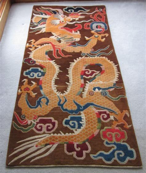 tibetan decorative dragon grasping  flaming pearls
