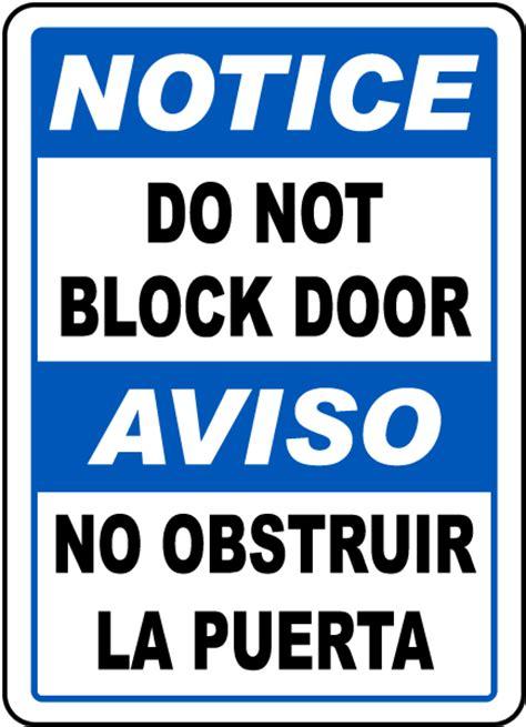 bilingual notice   block door sign