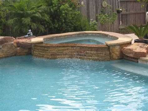 custom spa  stacked stone spillway custom pool water