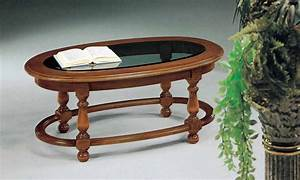 A coffee table on a frame of solid wood with glass insert for Wood coffee table with glass insert