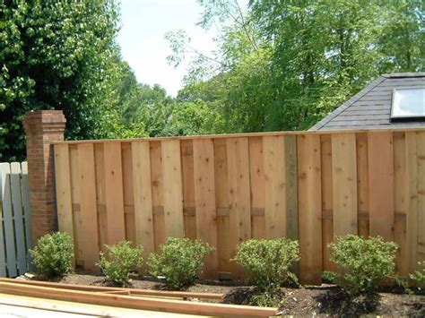 brick and wood fence pictures wood fences custom wood privacy fence with cap cedar fence photo video gallery 4u2032