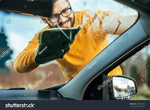 Shot Satisfied Man Cleaning Windows On Stock Photo 580223425