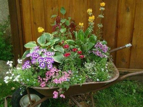 wheelbarrow planter ideas 82 best wheelbarrow garden images on
