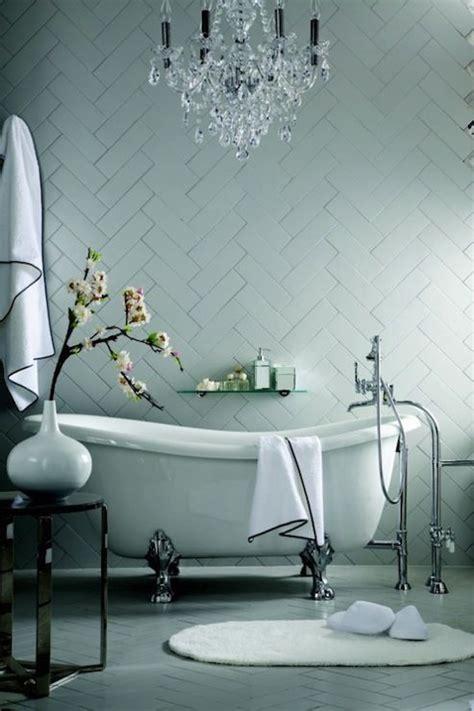stunning bathroom   herringbone tile wall  crystal
