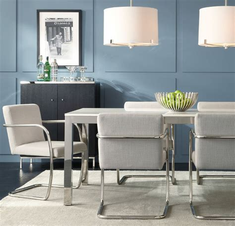white quartz dining table love this white quartz and stainless steel parsons table