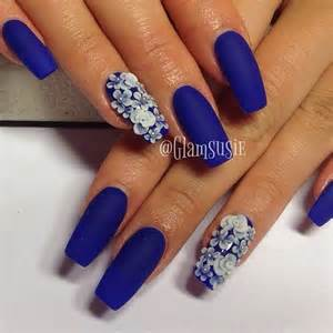 Floral inspired dark blue nail art design the matte polish