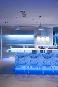 Wonderful blue led light under the kitchen island also bar