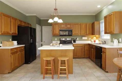kitchen wall colors with honey oak cabinets designer kitchen with oak cabinets and black granite 9845