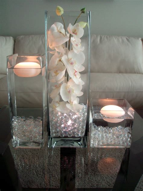 The 3 Pc Glass Vase Set Filled With Glass Or Acryllic