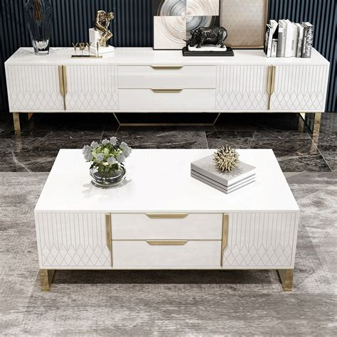 A storage coffee table with drawers or shelves can come in handy. Aro White Coffee Table with Storage Rectangular Coffee ...
