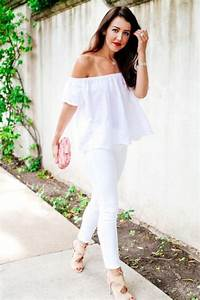 Picture Of white jeans an off the shoulder top a pink clutch and neutral cutout shoes