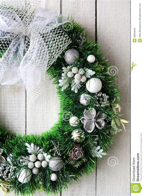 christmas wreath  white door royalty  stock images