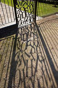 jumble of letters in a wrought iron gate with shadow cast With iron gate letters