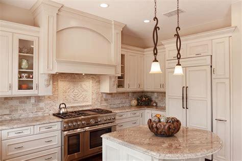 mediterranean kitchen with white cabinets a delightfully detailed mediterranean kitchen remodel