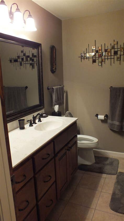 Bathrooms With Bronze Fixtures by Vanity In Burnt Almond Rubbed Bronze Fixtures
