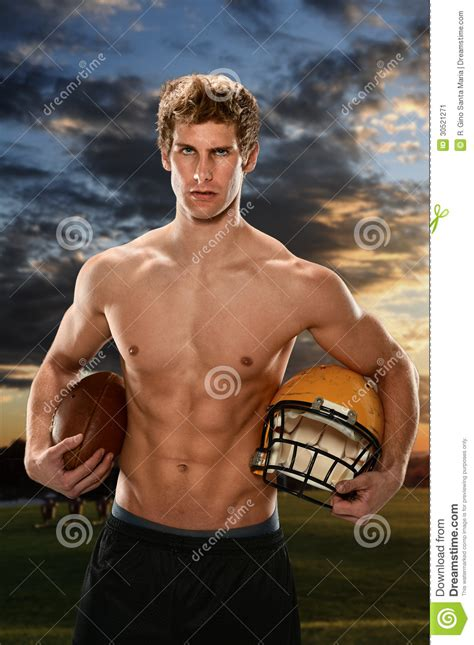 young man holding football  helmet stock image image