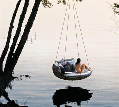 daniel pouzet s swingrest hanging outdoor lounge for dedon