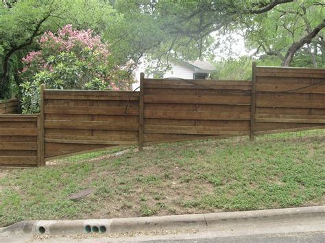 How To Build Backyard Fence by Wood Fence On Slope In 2019 Landscape Building A Fence