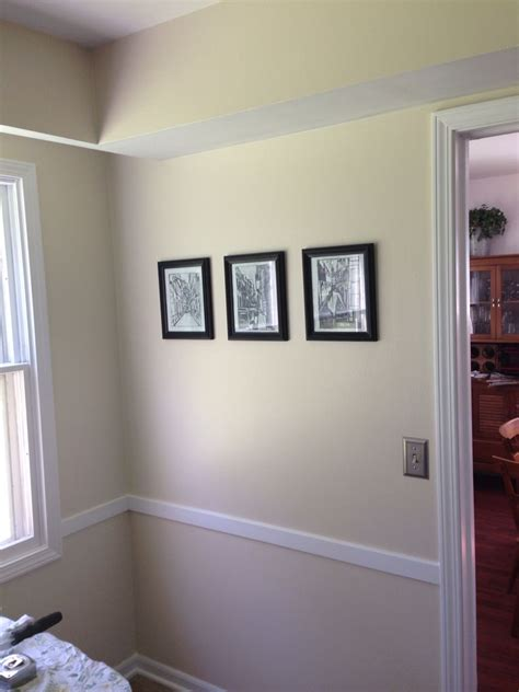 after new bright white trim and sherwin williams navajo
