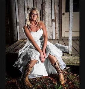 Rustic cowboy boots wedding dress fall wedding at for Wedding dresses with cowgirl boots