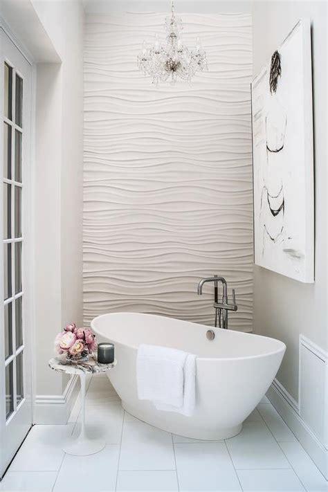 Crystal Chandelier Over Corner Tub With Marble Saarinen