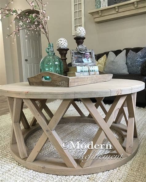 Small round coffee table in the middle can ensure the complete success of the plan. Gorgeous rustic round farmhouse coffee table by ModernRefinement | For the home | Pinterest ...