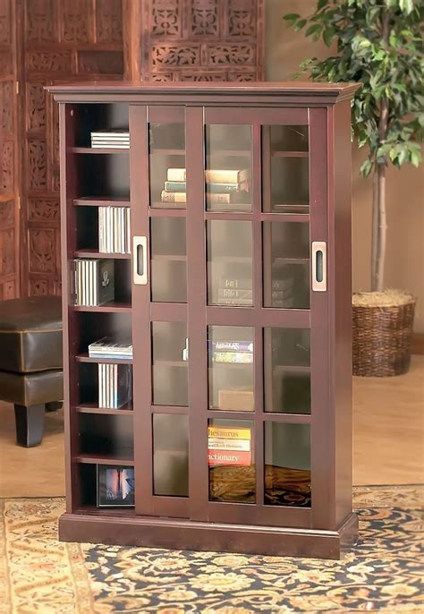 Brown Tall Wooden Bookcase Features Sliding Glass Doors On