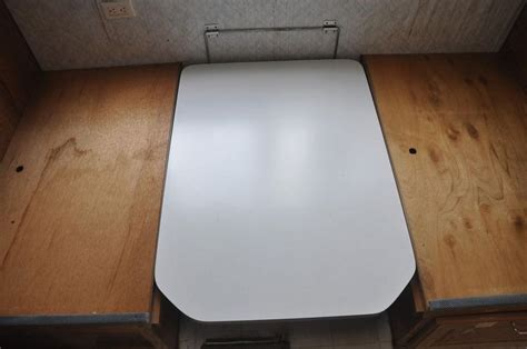 rv kitchen table parts sell used rv kitchen table with legs fold down for bed and