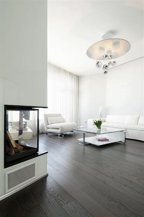 Living neutral soft furnishings with dark wood flooring