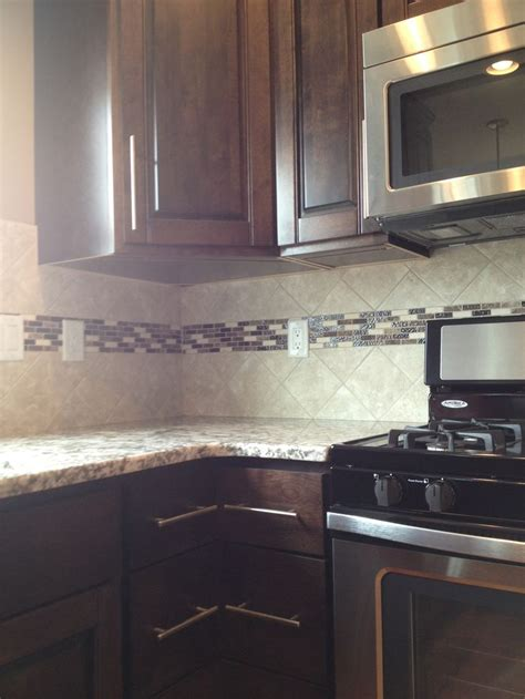 kitchen backsplash  accent strip kitchen tiles